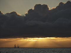 Sunburst Findhorn, Findhorn, Moray, Scotland, sunset, summer, dredger, crepuscular, rays, grey, cloud, rim, silhouette,