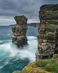 Violent and tempestuous conditions on a Spring morning at Duncansby with gigantic waves pounding the sea stacks and cliffs on the Caithness coast