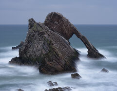 Tempest Bowfiddle Rock, Portknockie, Moray, Scotland, snowfall, coast, dark, forbidding, cold, rough, winter, swell, pounding, rocks