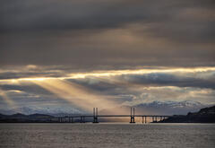 Theatre Lighting Kessock Bridge, Allanfearn, Highland, Scotland,  multiple, beams, light, sun, concealed, clouds, dappled, shoreline, bridge, silhouetted