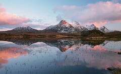 A blushing pink Ben Loyal and its mirror smooth reflection at Loch Hakel near Tongue.