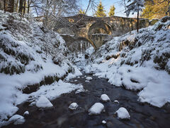 Winter Embers Craigmin Bridge, Drybridge, Buckie, Moray, two tier, arch gaping maw, scary, monster, icy, river, waded, snow, ice, rocks, unusual