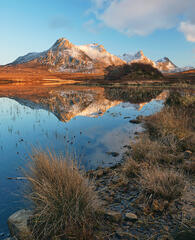 Sunlit gold painted Ben Loyal reflected in Loch Hakel during a Spring sunset.