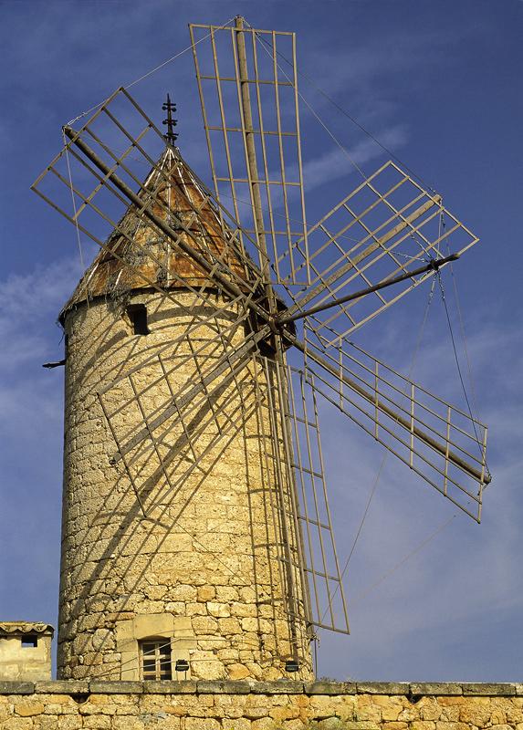 Antique Turbine, Casares, Andalucia, Spain, honey, sandstone warm, evening, light, skeletal, sails, picturesque, cloud,  photo