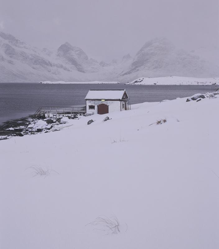 Bleak Boat House, Little Krystad, Lofoten, Norway, snow, fallen, tussock grass, stalks, boat, house, fluorescent, mounta photo