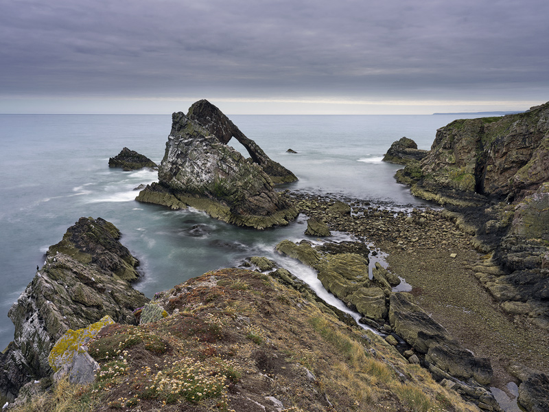 Bowfiddle Swell, Portknockie, Moray, Scotland, grey, summer, morning, rock, stack, swirling, sea, cliff  photo