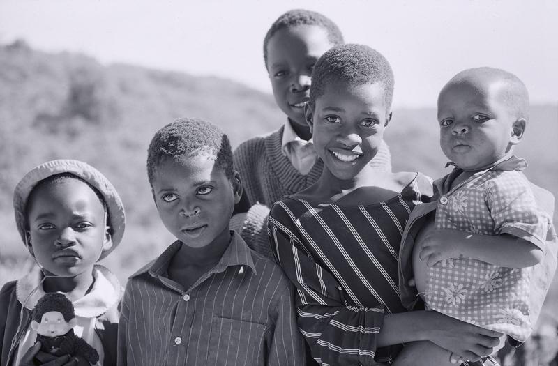 Chimanimani Family, Chimanimani, Zimbabwe, Africa, Agfa Scala,   rondaweil, mud, building, straw, group, children, blac photo