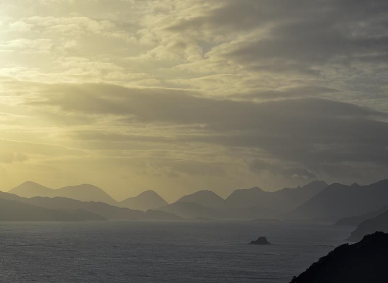 Cuillins Gold 2, Lealt, Skye, Scotland, serated, teeth, lemon, sunlight, mist, rain, cloud, island. Holm, Minch, water photo