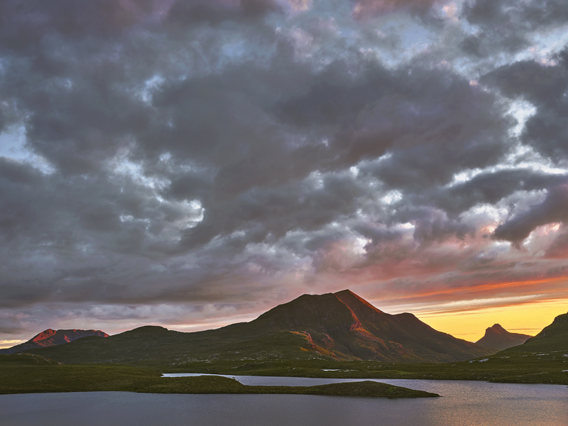 Embers on Stac Pollaidh, Knockan Crag, Assynt, Scotland, sunlight, flickered, blood, red, conical, summit, tangerine, cl photo