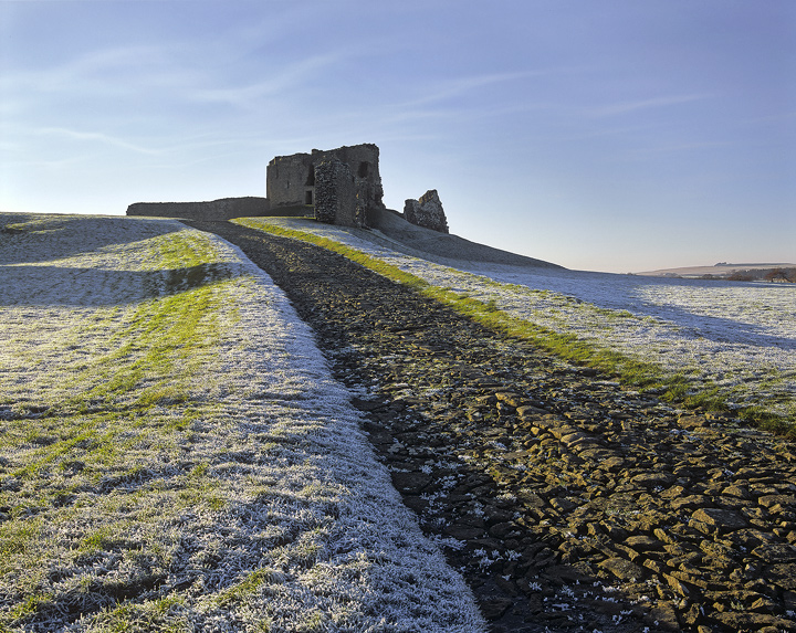 Ice Castle, Duffus Castle, Moray, Scotland, stripes, Duffus, isolated, alone, frost, thawing, grass, blue, shadows, path photo
