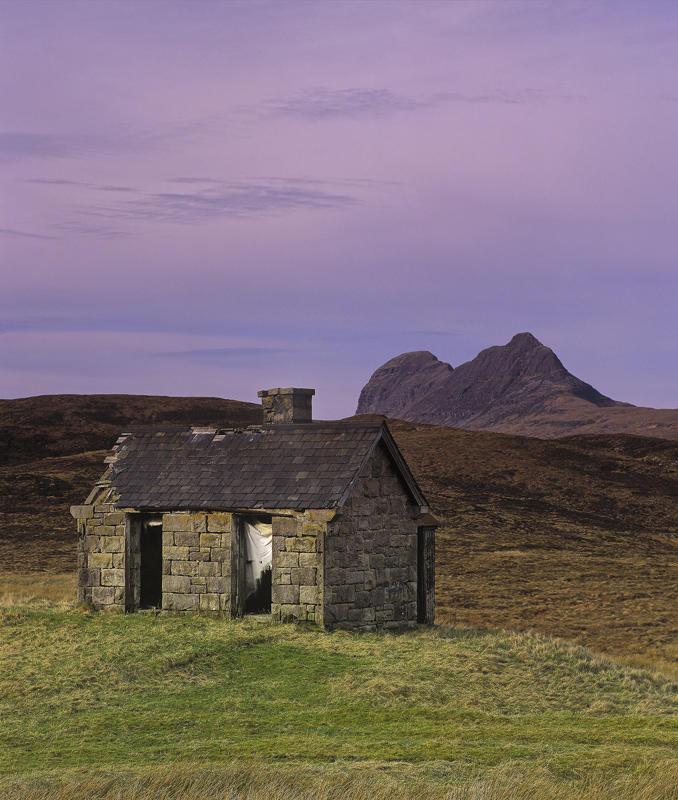 In Tatters, Elphin, Assynt, Scotland, stone, bothy, grass, mound, road, character, Cul Mor, Suilven, curtains, plum, sky photo