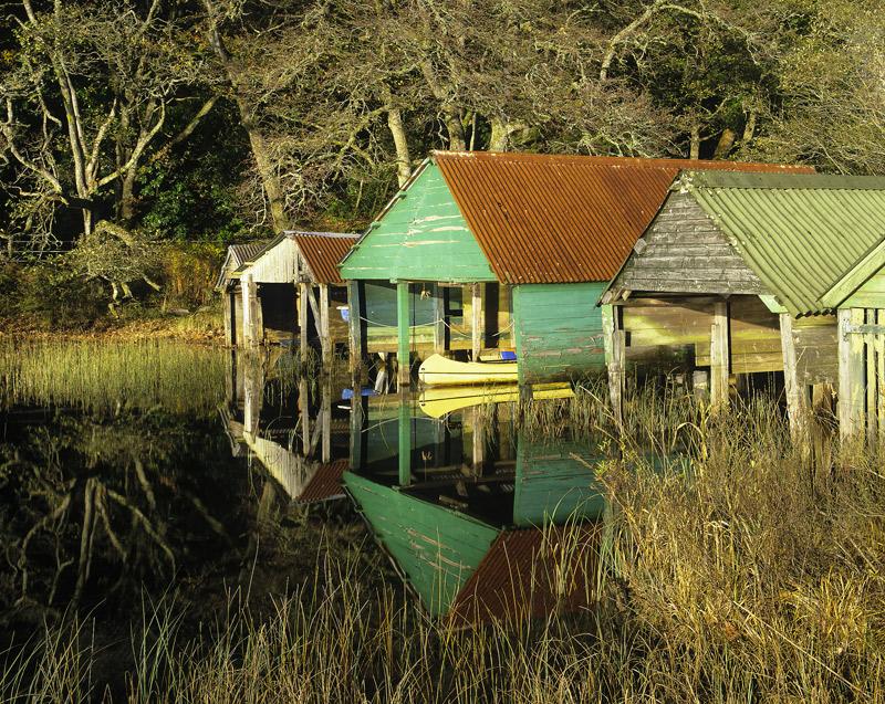Marine Retirement Home, Loch Ard, Trossachs, Scotland, colourful, rickety, evocative, reflection, golden, sunlight, reed photo