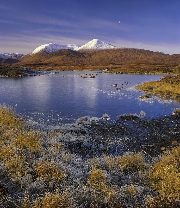Moon Over Black Mount, Rannoch Moor, Glencoe, Scotland, dazzling, bright, white, snow, dusted, peaks, blue, gold photo
