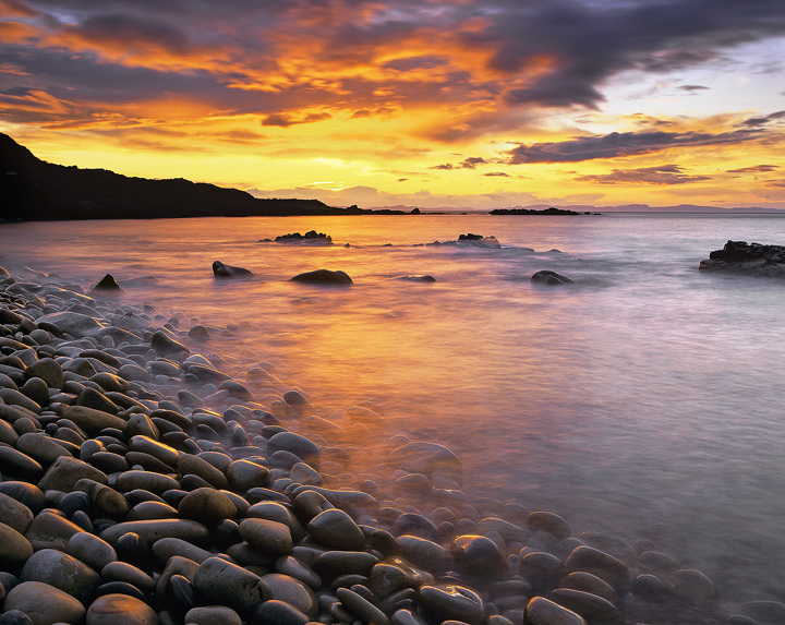 Rainbow Cove, Cove Bay, Moray, Scotland, pebbles, cascading, embankment, surf, rolls, rough, tumble, pale, colour photo