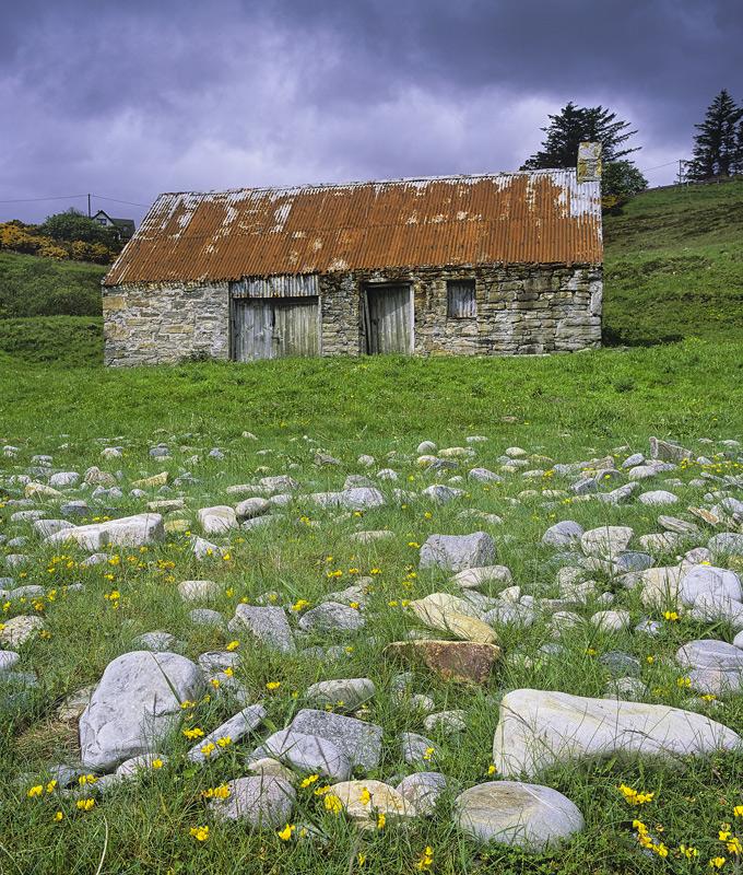 Rockery Talmine Bothy, Talmine Bay, Sutherland, Scotland, tiny, red, rusted, roof, bothy, stone, rocks, flowers, summer photo