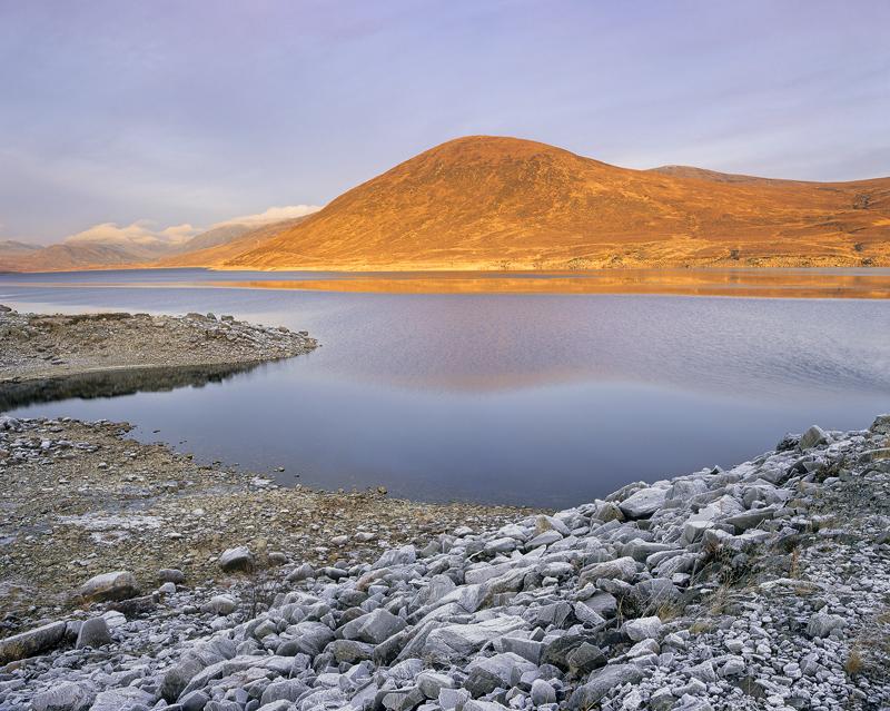 Sienna Glascarnoch, Loch Glascarnoch, Highland, Scotland, mound, hill, burnt sienna, frost, rocks, reflection, ruffled   photo