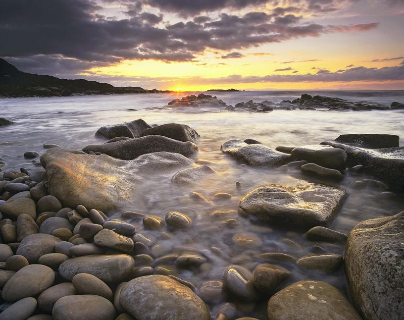 Stone Washed, Hopeman, Moray, Scotland, sun, cloud, spark, orange, rocks, pebbles, sea  photo