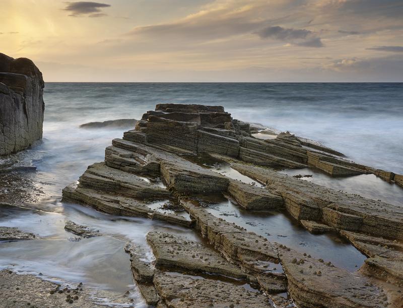 Tide and Motion Hopeman, Hopeman, Moray, Scotland, turbulent, irresistable, opposing, gold, blue, reflecting, banana, ti photo