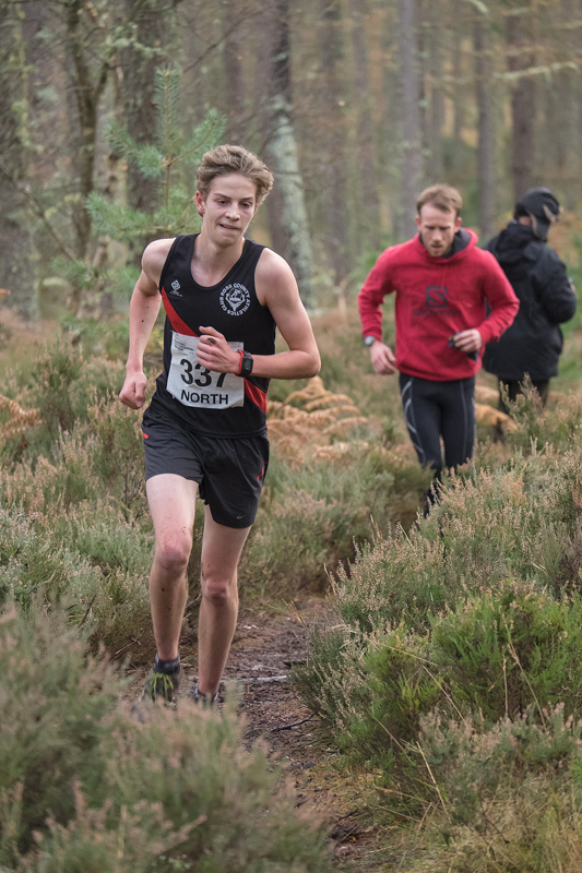 Finlay Todd (Ross County AC), clearly enjoying his winning margin over Cameron Main (Moray Roadrunners), on the final circuit...