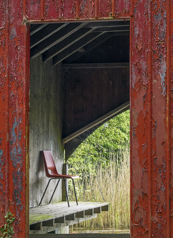 Vacant Posessions, Blairs Loch, Moray, Scotland, manmade, detritus, red, chair, incongruous, boat house, flaky, paint, w photo