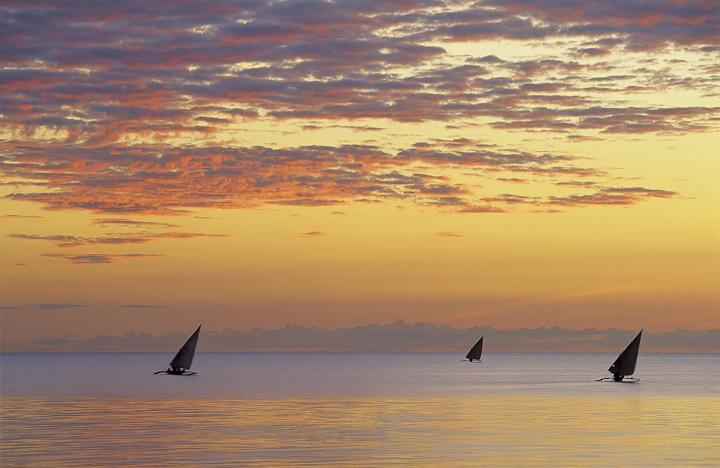 Zanzibar Magic, West Coast, Zanzibar, Africa, sunsets, evening, calm, ribbon, dappled, cloud, sun, three, silhouetted  photo