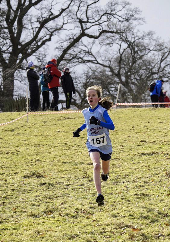 Charging down the last hill to the finishing bend behind the first place Group D runner Valencia Wright is Hannah Ryding from...