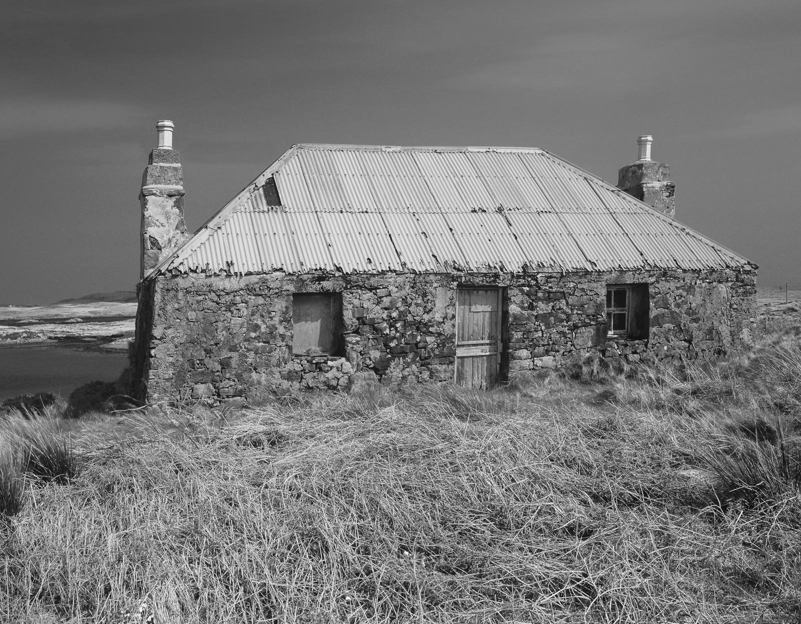 This old bothy abandoned close to the port town of Lochmaddy in North Uist had a glorious rusty red tin roof a stone facade and...