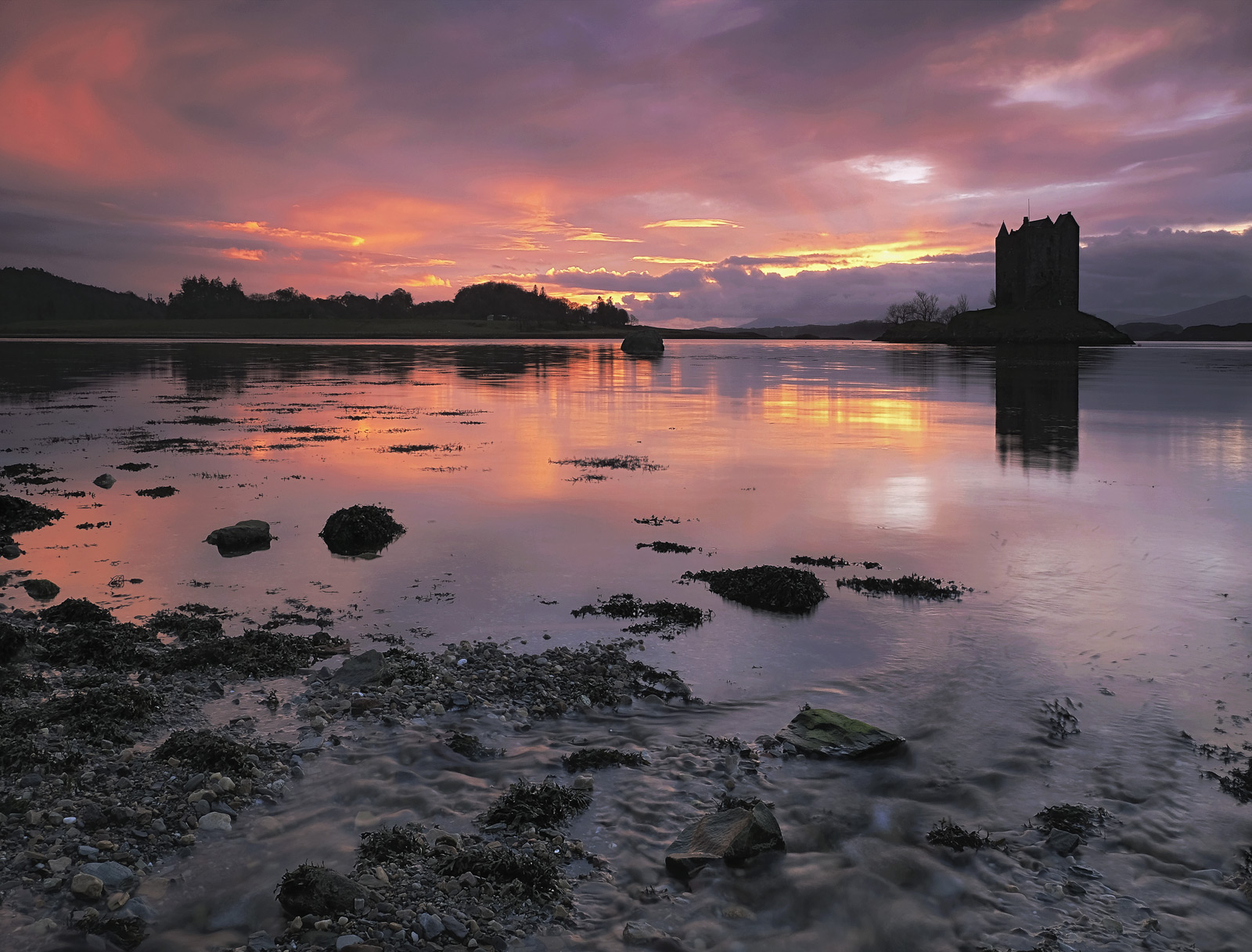 Arguably the most colourful phase of this stunning west coast sunset over the silhouetted shape of Castle Stalker, the...