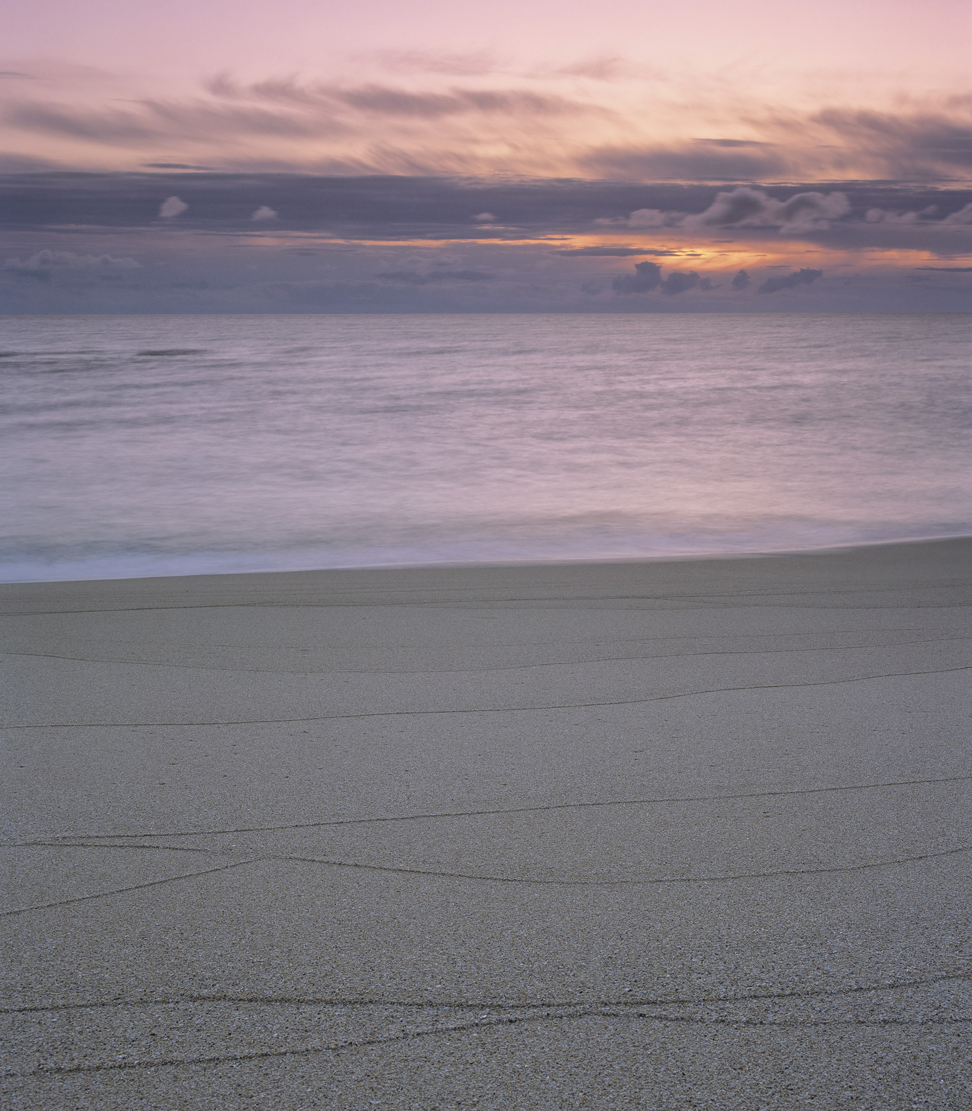 Traigh Mhor has a very coarse grained sandy beach which is quite orangey in colour and being subject to west coast tides with...