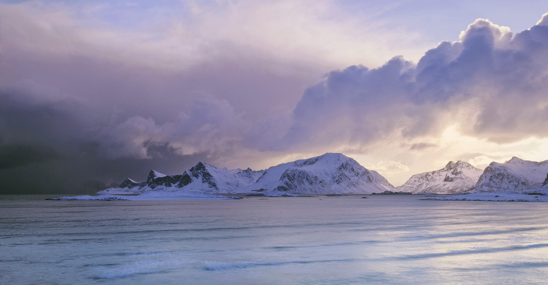 The most amazing clouds billowed off of the Flakstad peaks as viewed from across Yttresand bay shortly after sunrise. The...