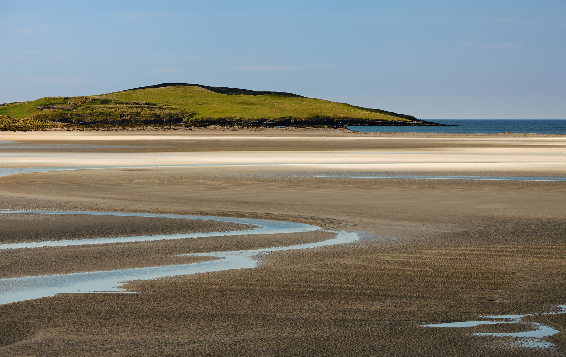 Gorgeous tidal artwork within the tidal basin of Luskentyre bay as viewed from an elevated viewpoint at Loganstir in the Isle of Harris