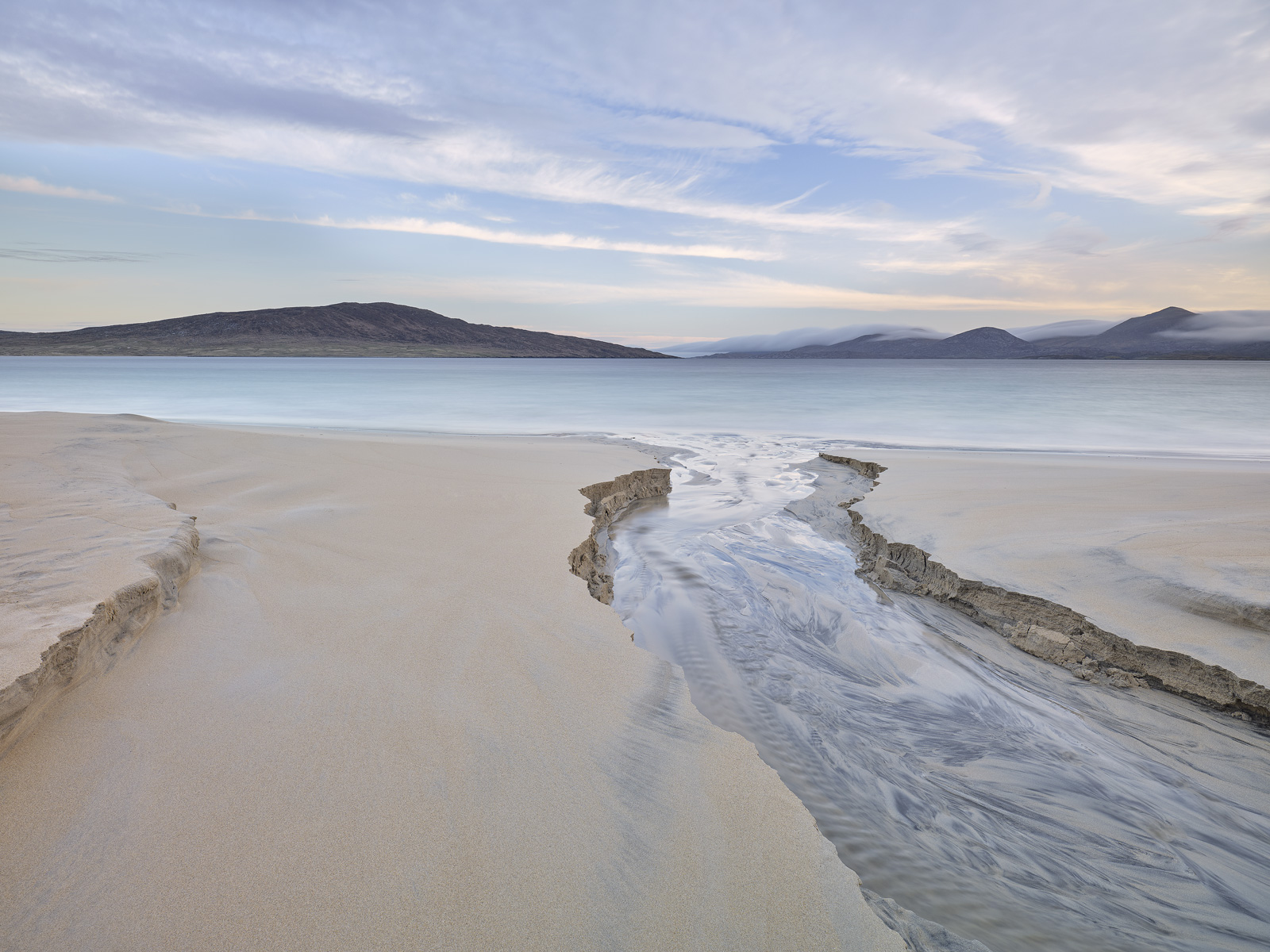 Sand carving on the immaculate and unblemished beach at Traigh Rosamol on Harris.