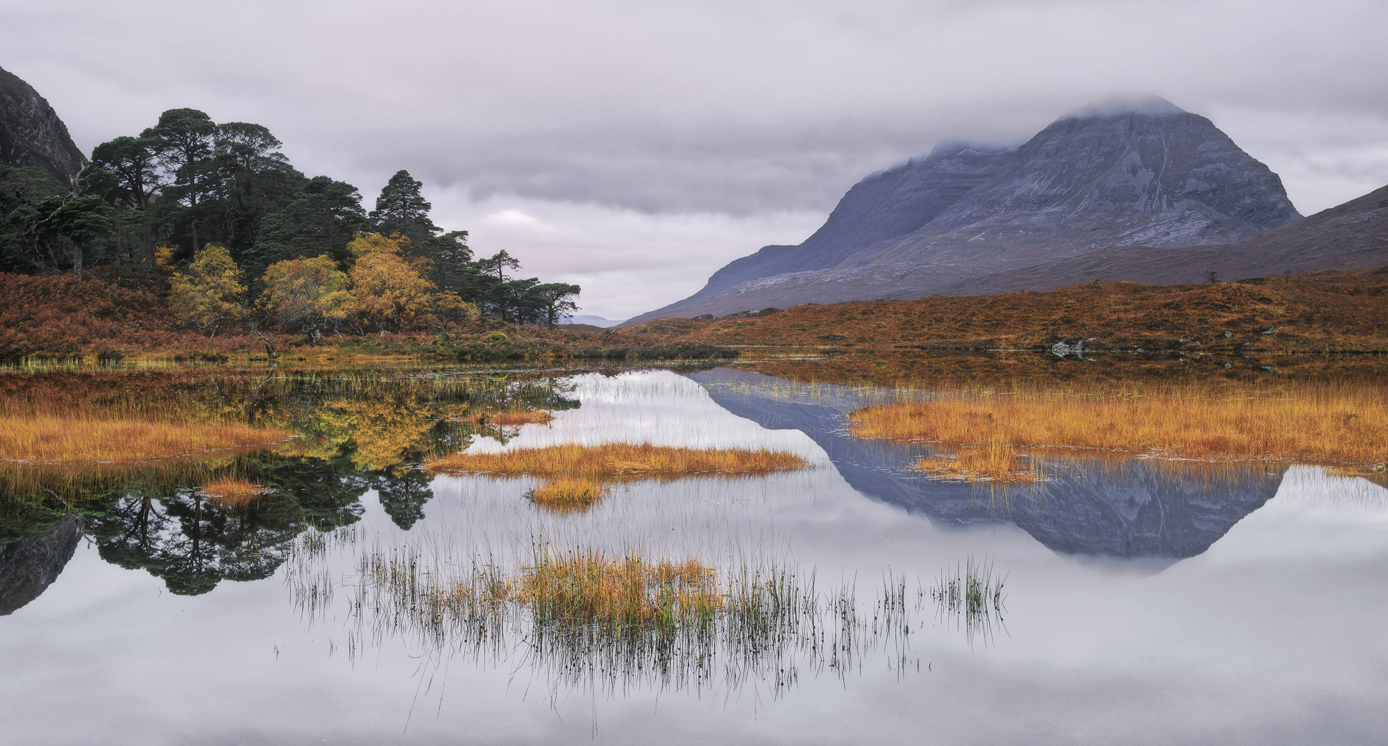 Loch Clair had undoubtedly reached the peak of Autumn colour. The Deer grass islands were of such a luminous orange hue...