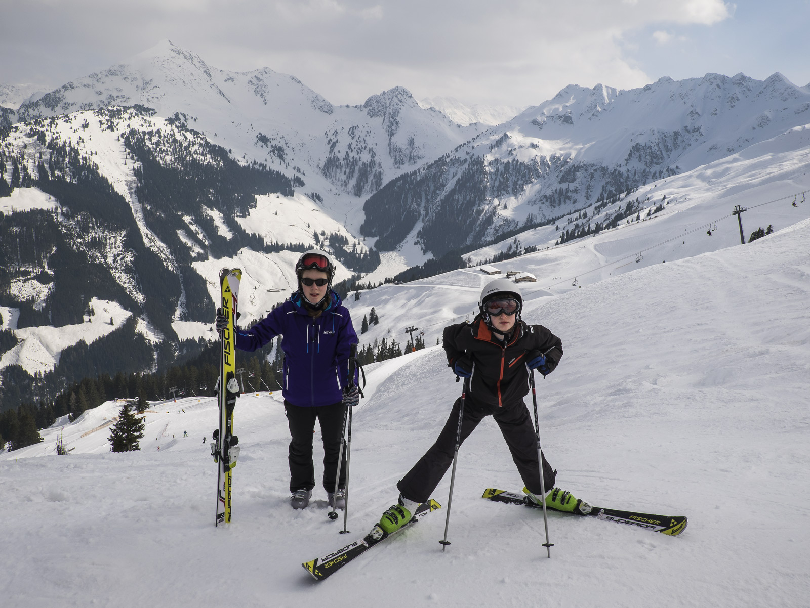 Ben and Lauren posing in front of the Austrian Alps at the top of the main gondola station in Alpbach, a rare moment when the...