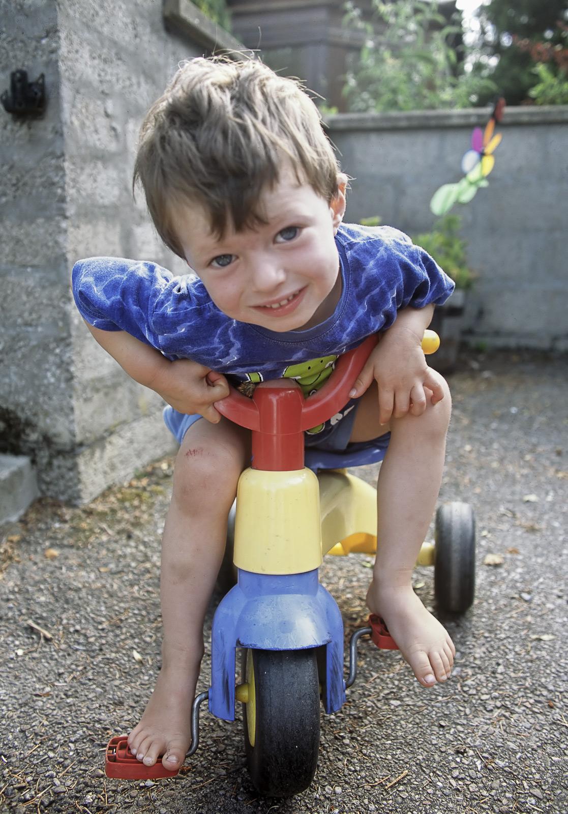 Ben on Trike, Forres, Moray, Scotland, nostalgic, Ben, scraped, knee, bruise, excitement, legs, scanner, dust, photo