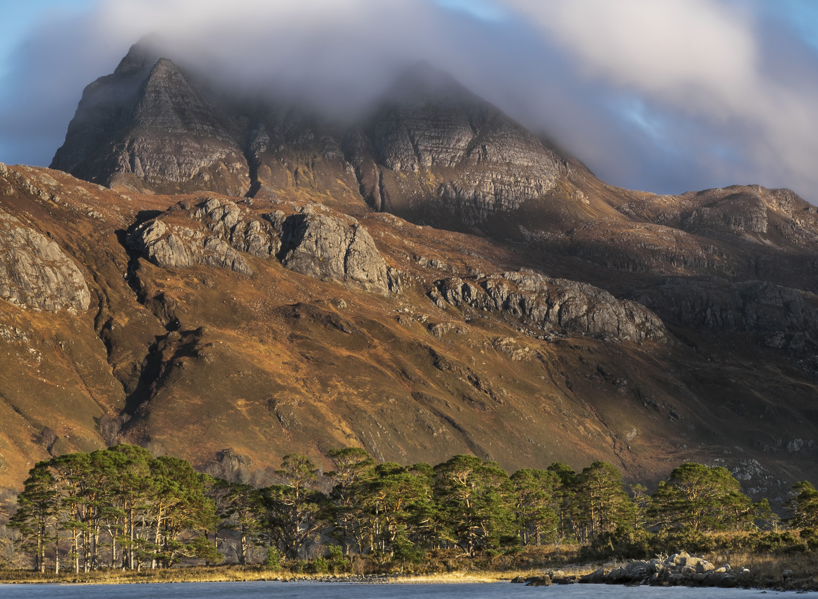 I have always thought of the magnificent and stately mountain peak of Slioch Lording over Loch Maree as having the appearance...