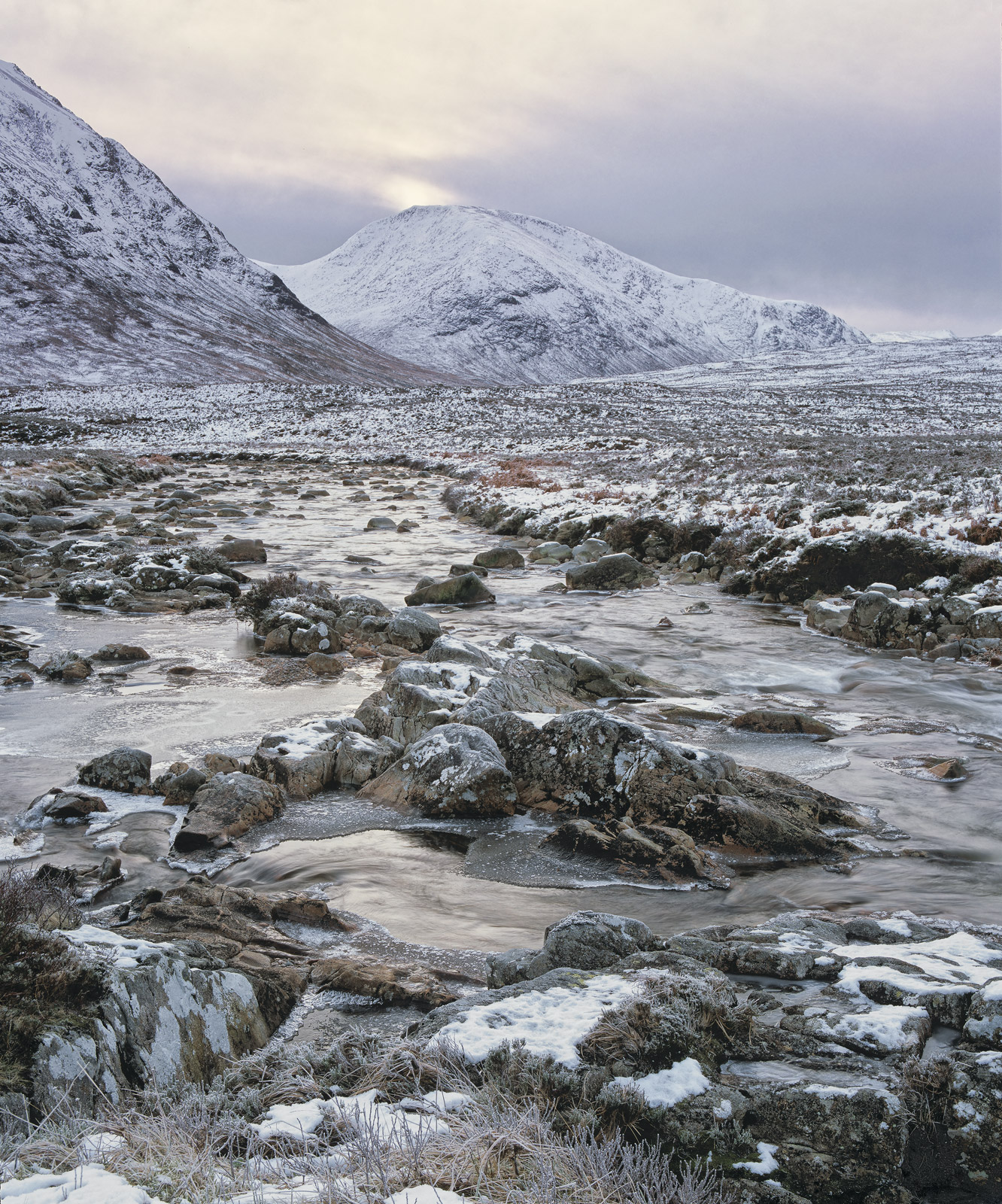 Exploring the river Coupall as it twists and meanders through heather moorland beneath the mighty Buachaille etive mor, I came...