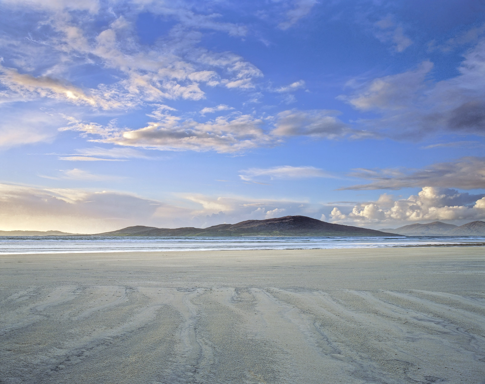 Surely one of the biggest and most majestic beaches in the UK.  Luskentyre bay is so vast that sunrise and sunset are viable...