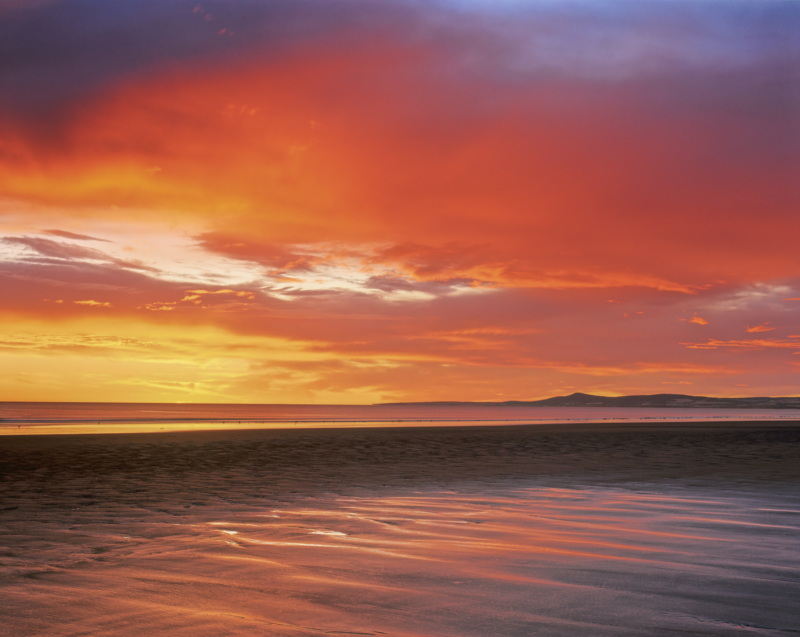 An astonishing colourful sunrise materialised over Lossiemouth's gorgeous east coast beach with the sky like fire, iridescent...