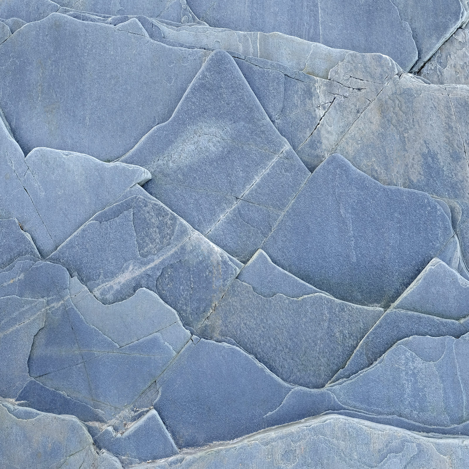This amazing pattern in a flat slab of fractured rock looked all the world to me like the overlapping layers of mountains that...