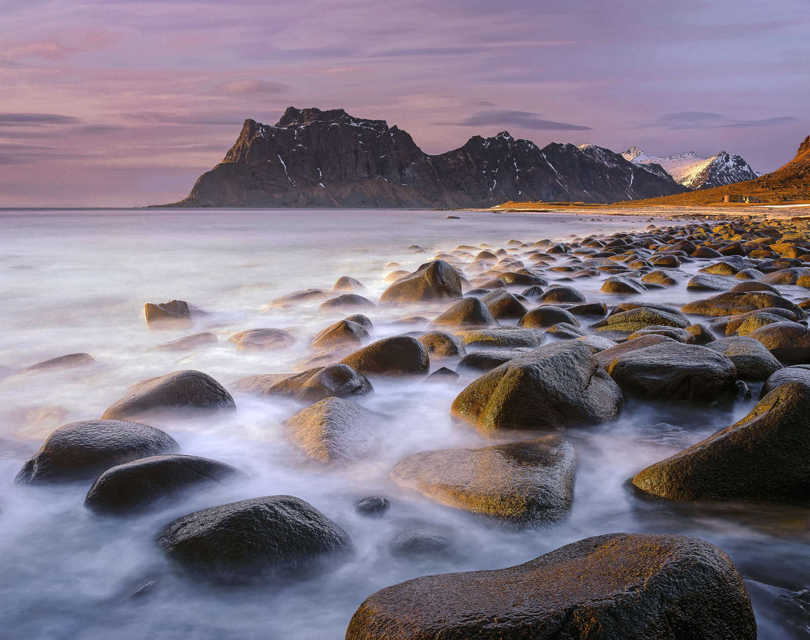 Beautiful big sculpted smooth black boulders make up the beach at Uttakliev like a causeway for giants. I used a very long...