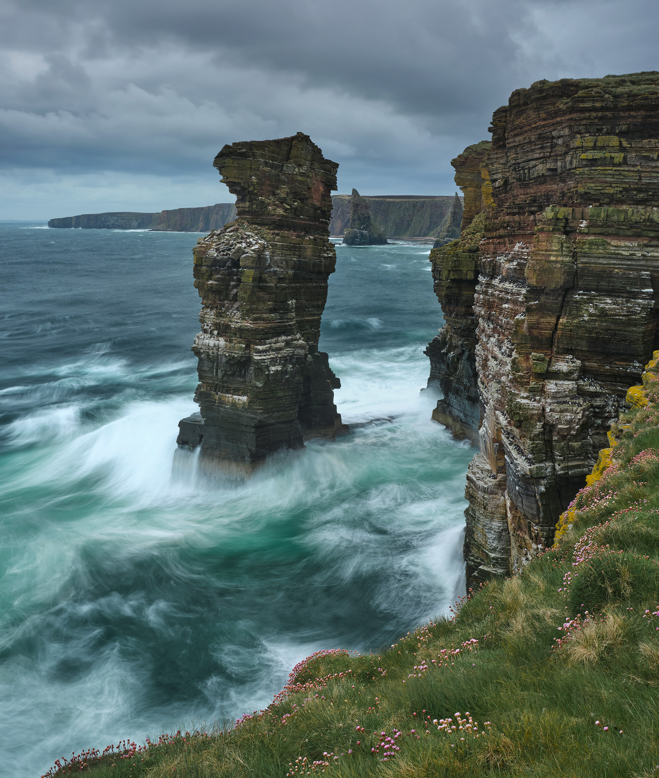 Turquoise waves pound the sea stacks and cliffs around Duncansby on the Caithness coast.