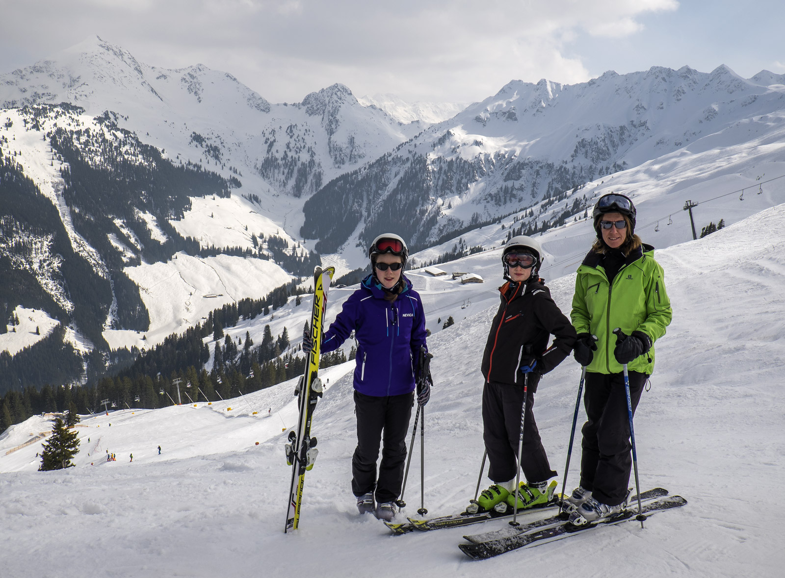 Ben, Lauren and my wife Hilary posing at the top of the gondola station in front of the immensely beautiful Austrian Alps at...