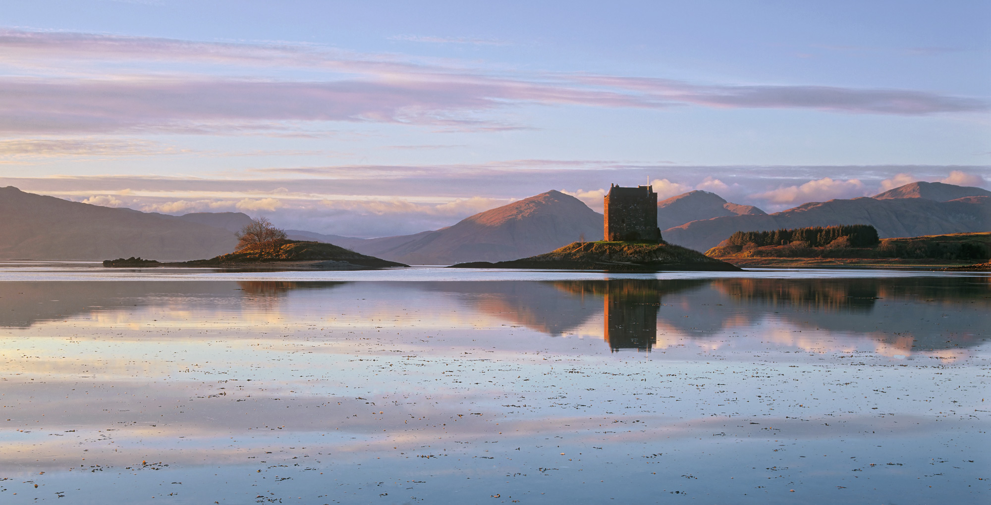 Castle Stalker on the Argyll coast is such a romantic place, cut off from the shore it sits on a low grassy island and is used...