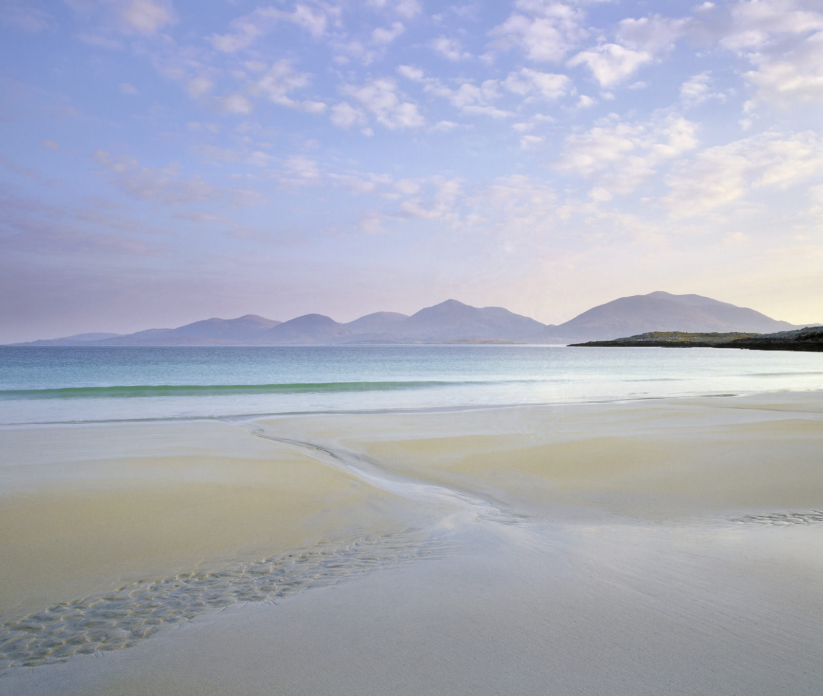 Definitely one of Scotland's finest beaches, Traigh Rosamol on the Isle of Harris has an enormous stretch of golden sand, Taransay...