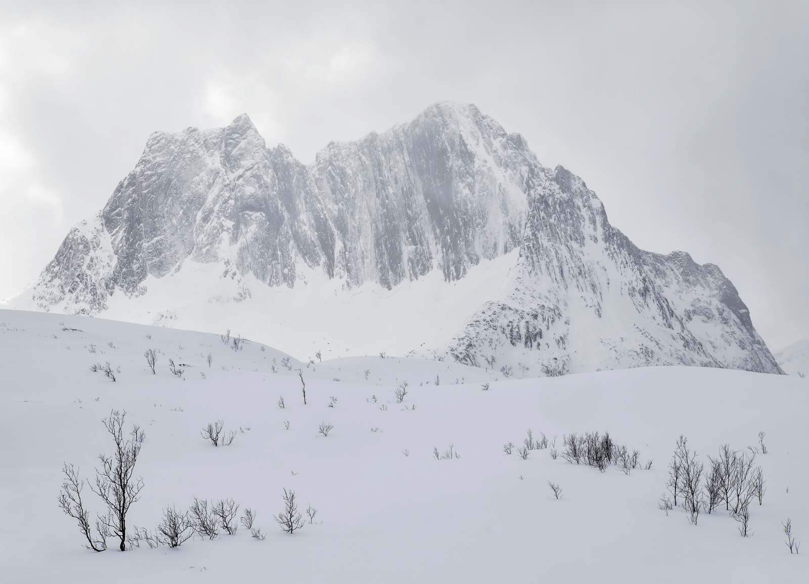 Low subdued sunlight and light sleet combined to render this impressive mountain in recessive shades of grey until it had the...