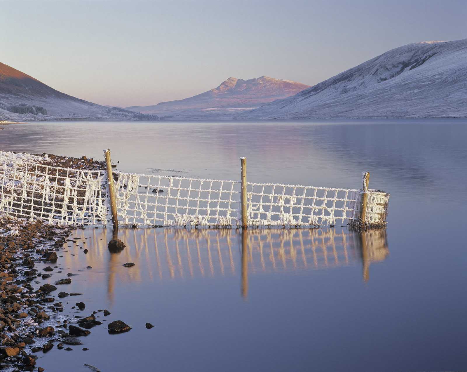 A freezing day at the edge of Loch A Chroisg on route to the impressive snow covered peaks of the Torridon mountains. A...