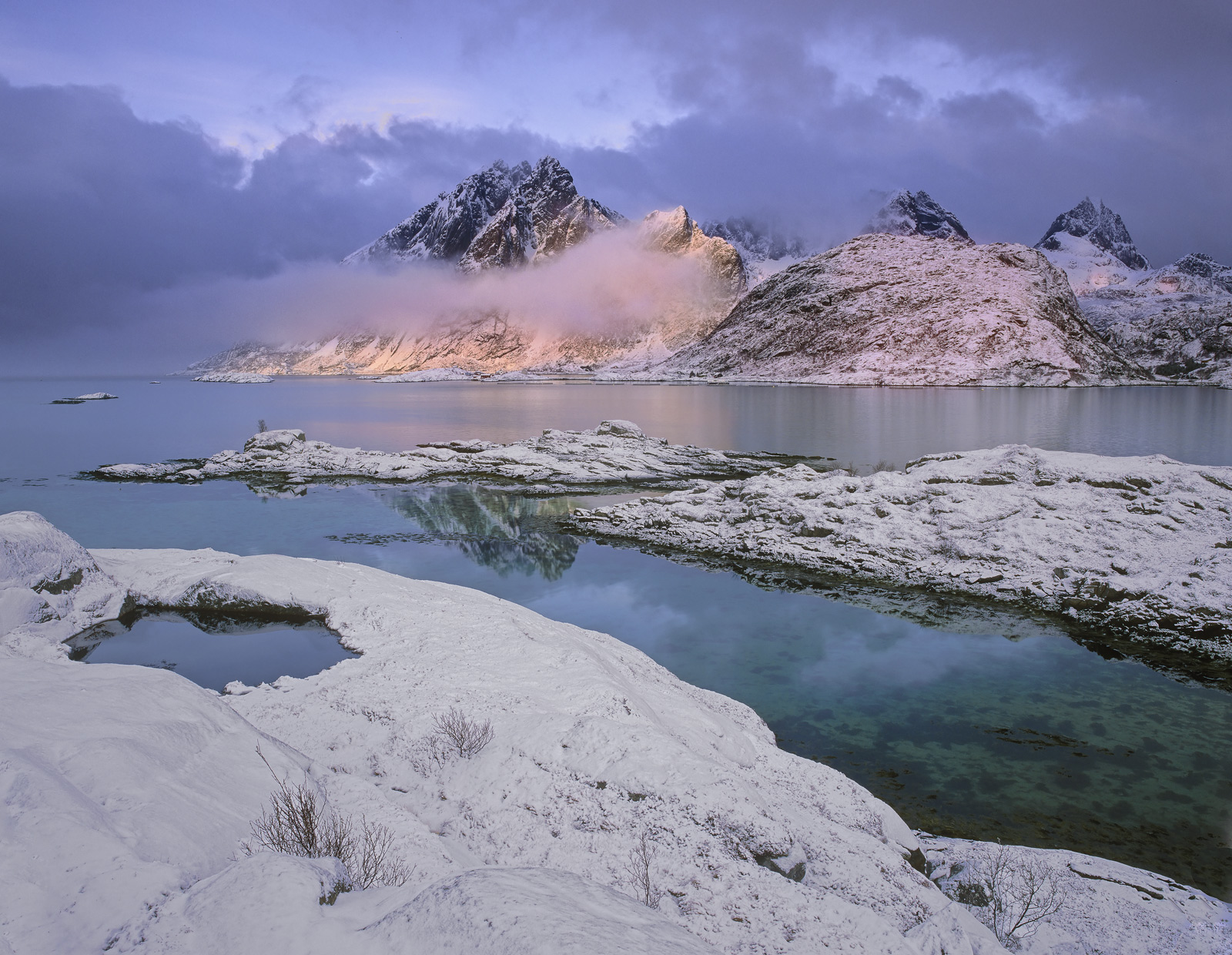 A final flurry of new snow settled across the roads that skirt the amazing mountains of Lofoten. I hoped that the sun would...