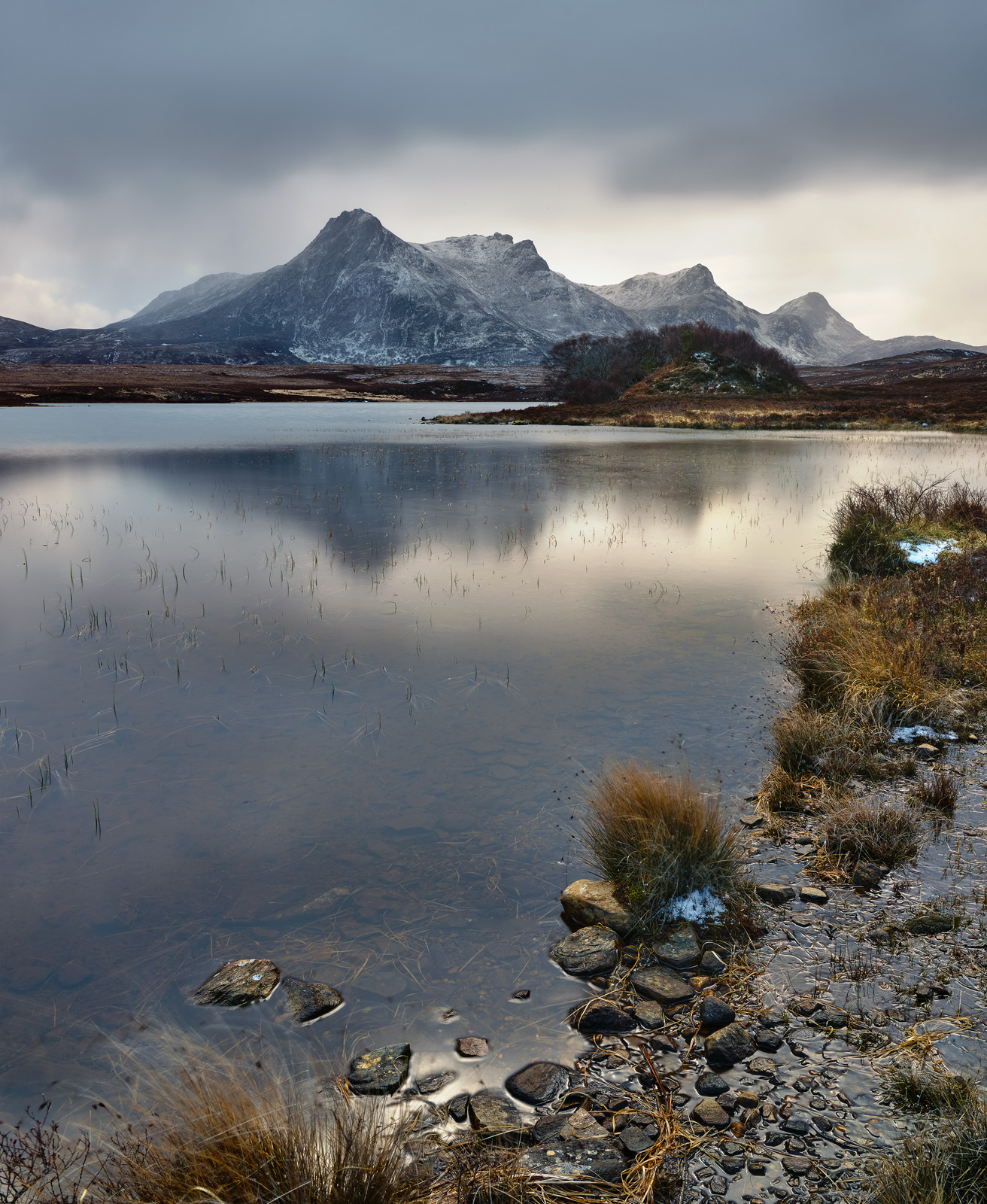 Close to the village of Tongue beside Loch Hakel I managed to capture a moody blue grey sky hanging over snow dusted Ben Loyal...