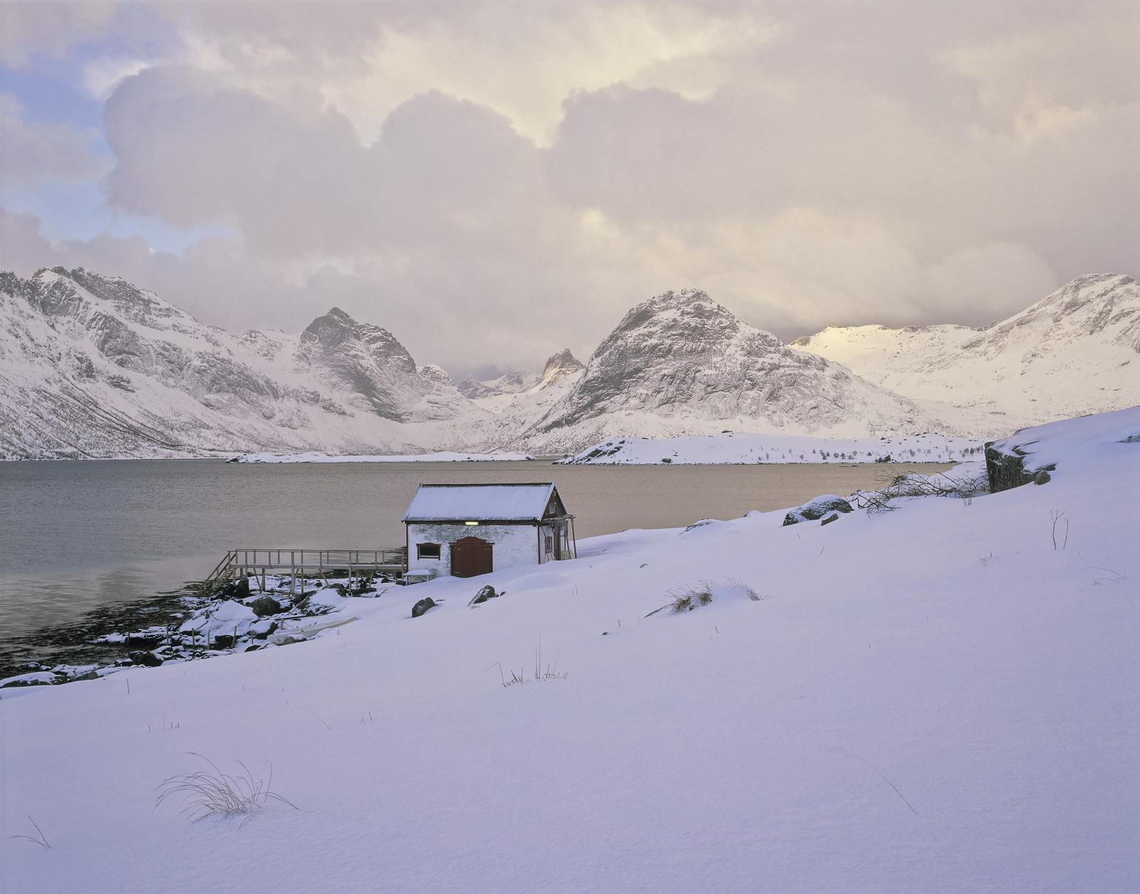 Cool Krystad, Little Krystad, Lofoten, Norway, squall, clouds, snow, hut, rorbua, reflection, fjord, photo